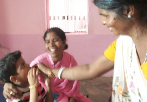 Staff assist a sick boy with medication